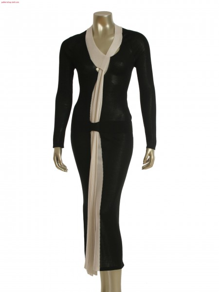 Fully Fashion 2-color intarsia evening dress with layer technology. Scarf and collar integrated.