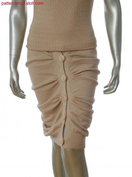 Seamfree gathered skirt in single jersey, tubular and alternate knitting with integral button holes.